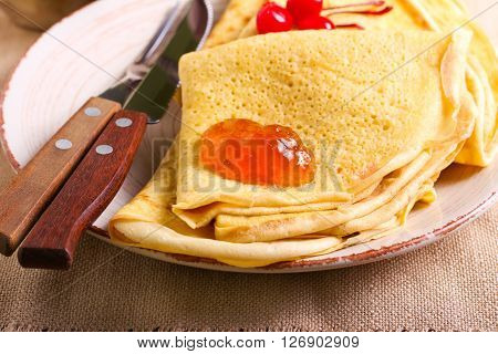 Crepes with marmalade on plate selective focus