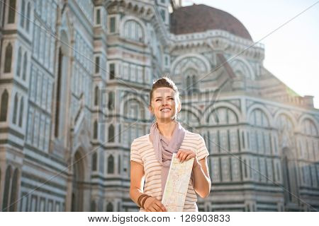 Happy Woman Tourist With Map Standing In Front Of Duomo, Italy