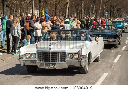 NORRKOPING, SWEDEN - MAY 1: Cadillac De Ville Convertible 1970 atcClassic car parade celebrates spring on May 1, 2013 in Norrkoping, Sweden. This parade is an annual tradition in Norrkoping on May Day.