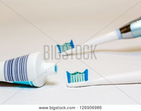 Electric toothbrush on a white background personal hygiene the instrument
