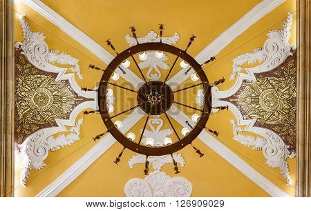 MOSCOW - MARCH 3: Close-up of chandelier and arhitecture details at ceiling of Komsomolskaya metro station on March 3 2016 in Moscow. Komsomolskaya is one of the most attractive metro station in Moscow.