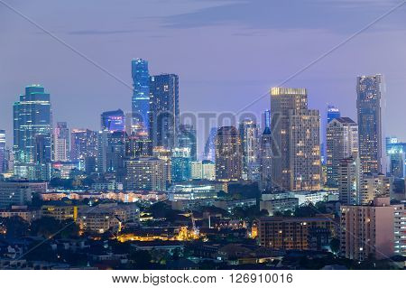Aerial view, office building lights during twilight