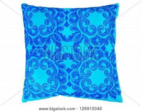 Blue decorative pillow with a pattern of colored threads embroidered. Isolated on white background.