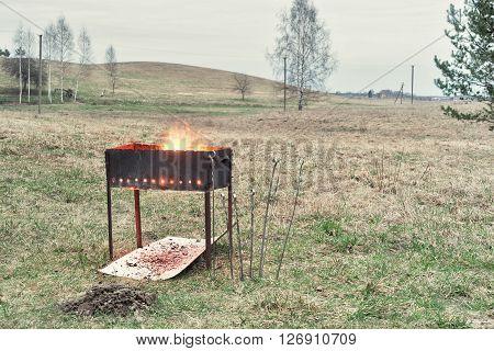 brazier with burning woods, charcoal preparation to bake shashlik