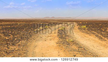 road to the Sahara desert comes to mountains Morocco