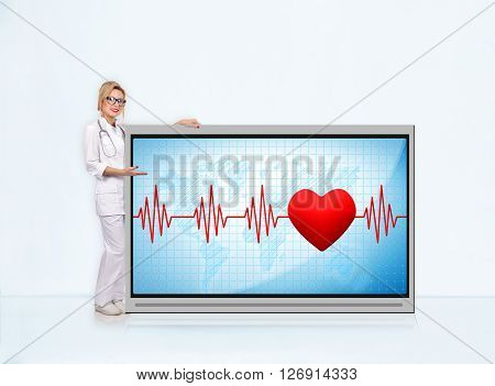 woman doctor with stethoscope showing pulse rate on tv screen