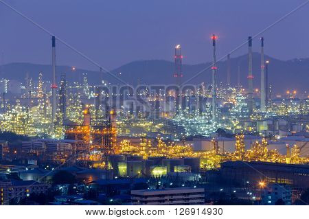 Twilight, refinery petrochemical lights with mountain background