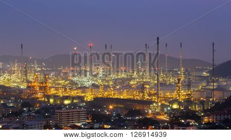 Aerial view refinery petrochemical lights with mountain background