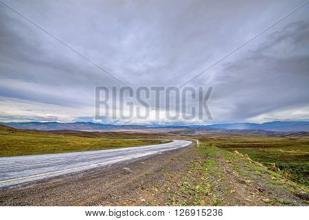 summer mountains and hazy sky landscape with road