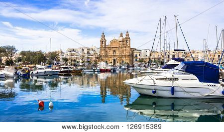 Landmarks of Malta - Msida cathedral and marina with the sail boats in Valletta