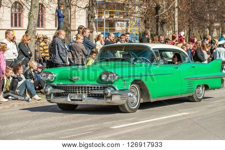 NORRKOPING, SWEDEN - MAY 1: 1958 Cadillac Sedan De Ville at classic car parade celebrates spring on May 1, 2013 in Norrkoping, Sweden. This parade is an annual tradition in Norrkoping on May Day.