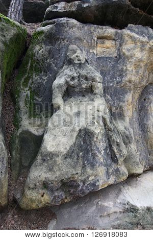 Harpist - Rock Sculptures - sculpture of the girl with a harp