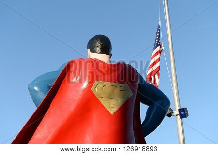 Metropolis, IL, USA - March 25, 2016: Statue of Superman outside the Museum and hometown in Metropolis, Illinois