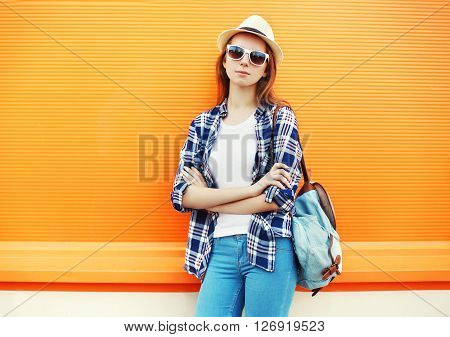 Fashion Pretty Woman Wearing A Sunglasses With Backpack Over Colorful Orange Background