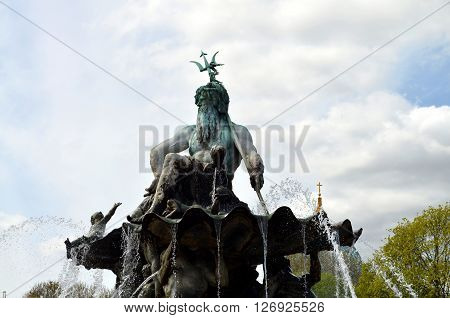 fountain of neptune in berlin with dome church in background
