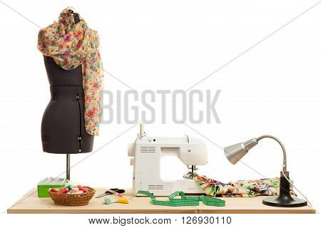 the sewing machine costs on a table near a dummy