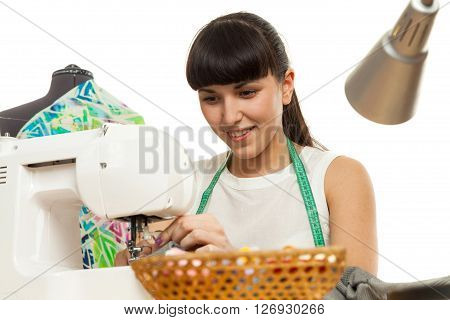 The Seamstress Sews A Product On A Table