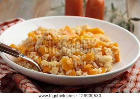 Pumpkin risotto on a rustic table
