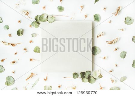 white wedding or family photo album dry and fresh branches isolated on white background. flat lay overhead view