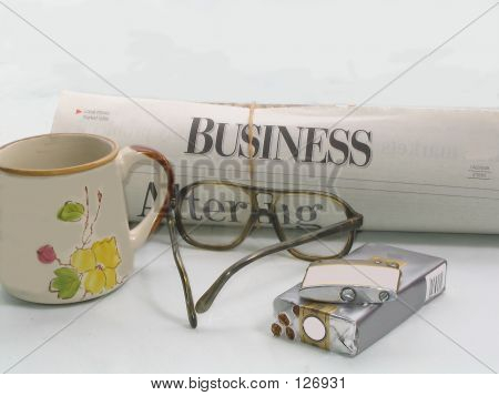 Picture or Photo of Newspaper,coffee,glasses,cigarettes,and a lighter