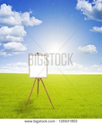 Bank for your text on a green grass against a blue sky with clouds