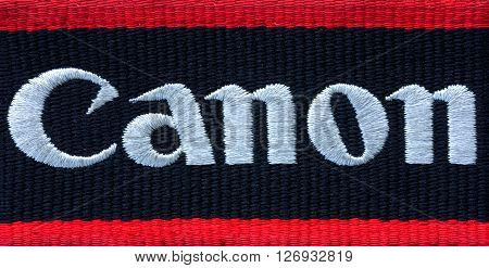 Kamennomostskiy Russia - 23 April 2016: the Canon Logo on the shoulder strap for the camera