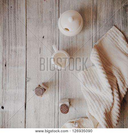 Milk sugar and towel at wooden table
