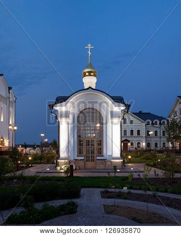 The orthodox baptistery chapel. Evening architectural lighting.