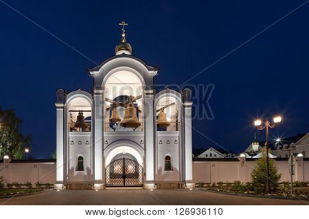 Evening panorama of orthodox temple complex. Architectural lighting of the belfry