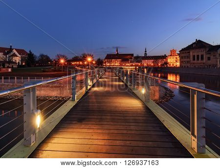 Pedestrian bridge over the Orda river in Wroclaw. Polish.