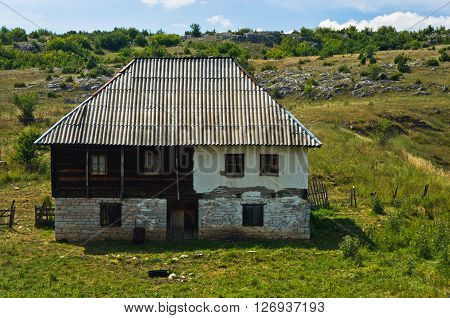 Old style stone and wood house at Pester plateau in southwest Serbia ** Note: Soft Focus at 100%, best at smaller sizes