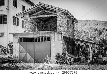 Italy, Udine, San Leonardo del Friuli - A small building used for stacking wood and agricultural tools