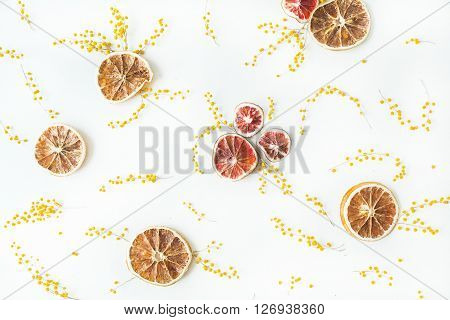 dry oranges candlesticks branches of mimosa isolated on white background. flat lay overhead view ** Note: Visible grain at 100%, best at smaller sizes