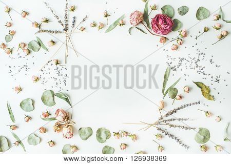 frame with roses lavender branches leaves and petals isolated on white background. flat lay overhead view