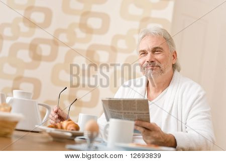 Senior Mature Man - Breakfast At Home With Newspaper