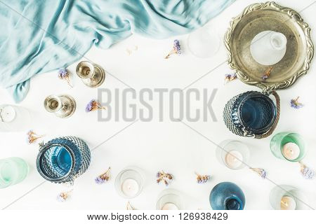 frame with vintage old-fashioned golden tray candlesticks flowers silk dress isolated on white background. flat lay overhead view