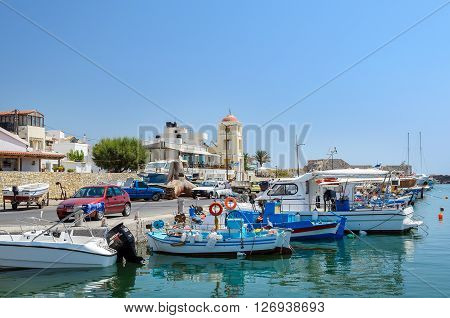 IERAPETRA, CRETE, GREECE - AUGUST  15, 2015: Fishing boats stay parked at port of Ierapetra town on Crete island, Greece