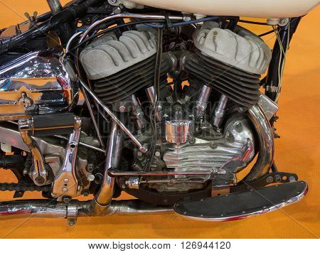 Closeup of a motorcycle engine and attachments