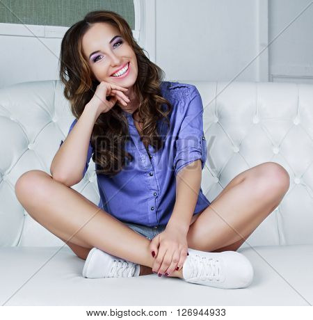 beautiful young model with curly hair in the interior