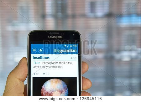 MONTREAL CANADA - MARCH 20 2016 - The Guardian newspaper mobile application on Samsung S5's screen. The Guardian is a British national daily newspaper.