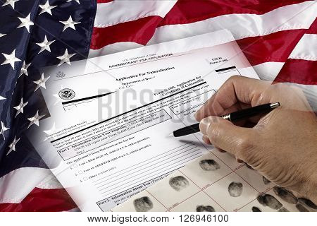 Man with American citizenship application on USA flag concept photograph