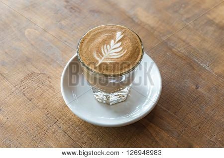 Glass Of Latte Coffee On Wooden Table
