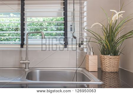Sink With Faucet On Black Kitchen Counter
