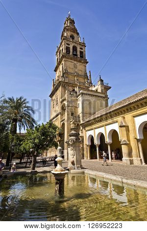 CORDOBA, SPAIN - September 10, 2015: The Bell Tower seen across a fountain in the Courtyard of the Orange Trees of the Mosque-Cathedral of Cordoba on September 10, 2015 in Cordoba, Spain
