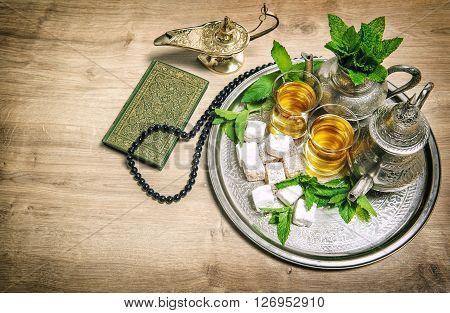 Tea glasses and pot. Oriental hospitality concept. Islamic holidays decoration. Ramadan kareem. Eid mubarak. Vintage style toned picture