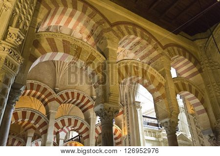 CORDOBA, SPAIN - September 10, 2015: View of the many columns and arches of the Great Mosque of Cordoba on September 10, 2015 in Cordoba, Spain