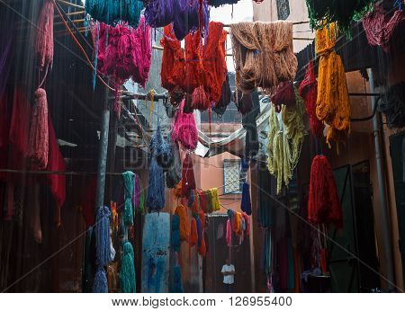 Marrakech, Morocco - Sept 24, 2015: Colored dyed yarn is dried on the streets of Morocco in Fes