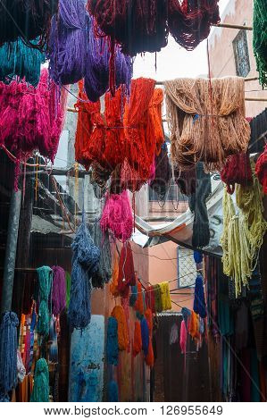 Colored dyed yarn is dried on the streets of Morocco in Fes