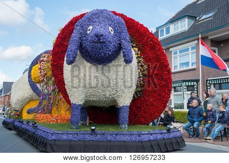 HILLEGOM, THE NETHERLANDS - APRIL 23, 2016: Platform with a frame made in a form of a sheep decorated with spring flowers. Taking part in the  traditional flowers parade