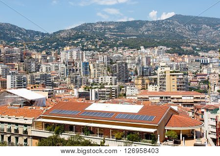 Color DSLR stock image of skyline of Monte Carlo in Monaco on the French Riviera with apartment buildings and condominiums. Horizontal with copy space for text